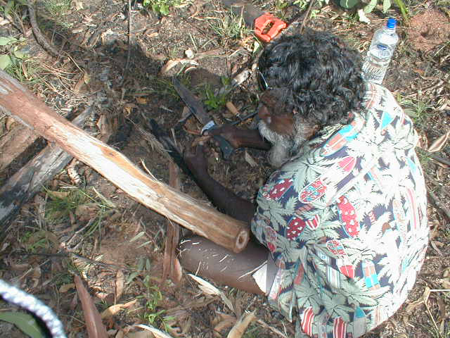 Djalu carving a didgeridoo